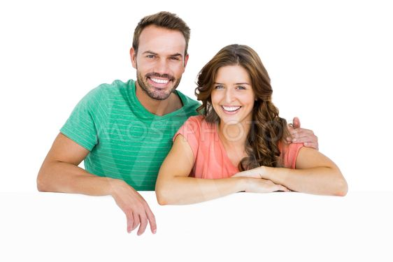 Happy young couple smiling at camera