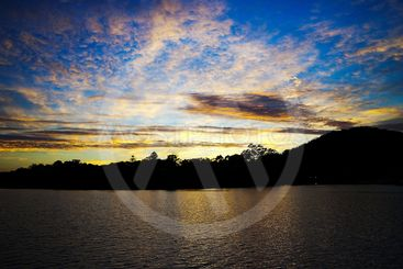 Dramatic gold blue sunrise seascape.