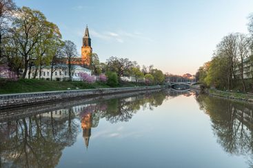 Calm Aura river and the cathedral in Turku, Finland in...