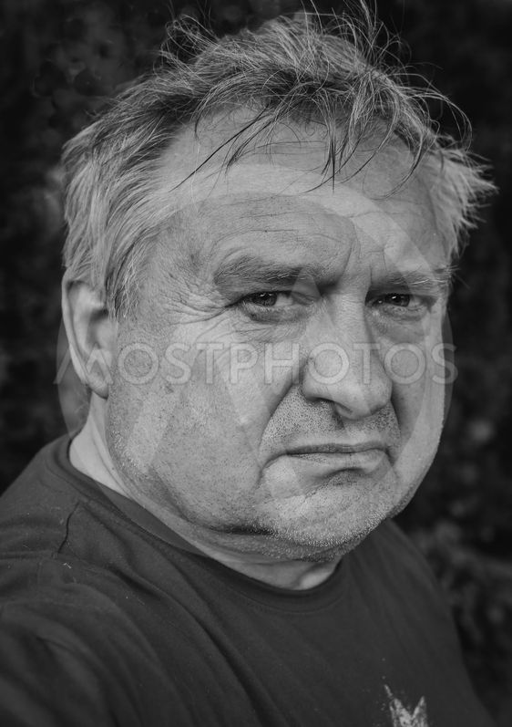 Old thoughtful man in park