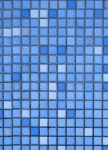 Vertical view of small blue tiles.