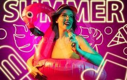 Beautiful girl isolated on studio background in neon light