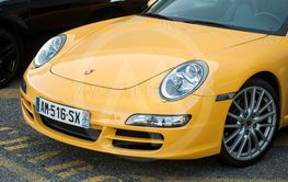 front view of yellow Porsche 911 parked in the street