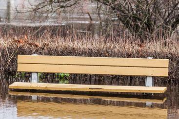 Flooded bench in park, Sweden.