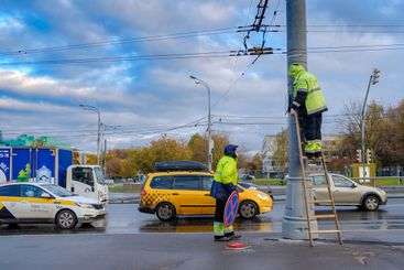 Moscow. Russia. October 19, 2020 Two workers in yellow...