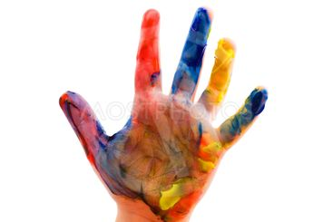 Childrens hand in the paint close up