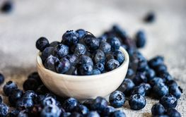 Organic blueberries on stone background
