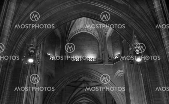 Looking through a series of arched sandstone doorways in...