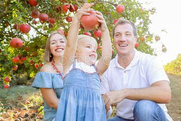 Portrait of happy parents with cute little blondy baby...