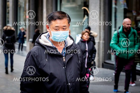 Man with mask to prevent spread of coronavirus in Madrid