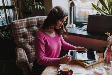 Happy pretty female working in the coffee shop