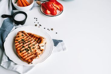 Grilled turkey steak with herbs and spices in a white...