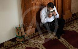 Muslim Man Kissing Holy Islamic Book Koran