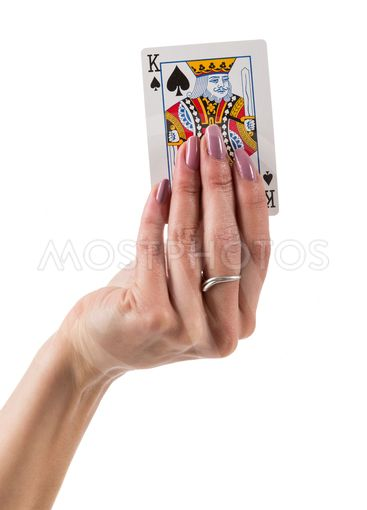 Female hand showing spades lord card