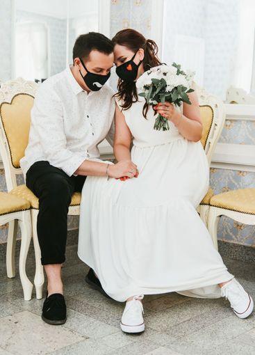 Wedding during the coronavirus period. Bride and groom...