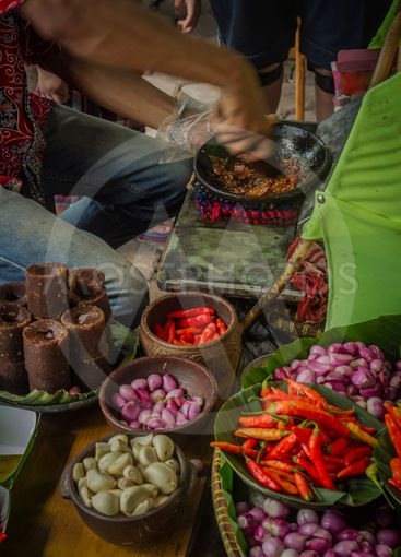 The seller is making special sambal for traditional fried...