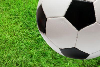 football soccer ball over green grass