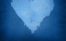 White watercolor painted heart shape over dark blue