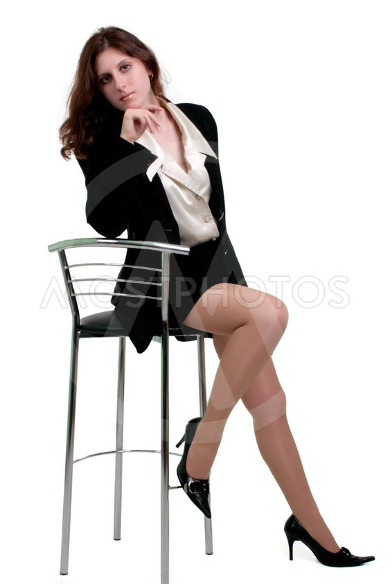 young woman posing in business suit  Isolated over white