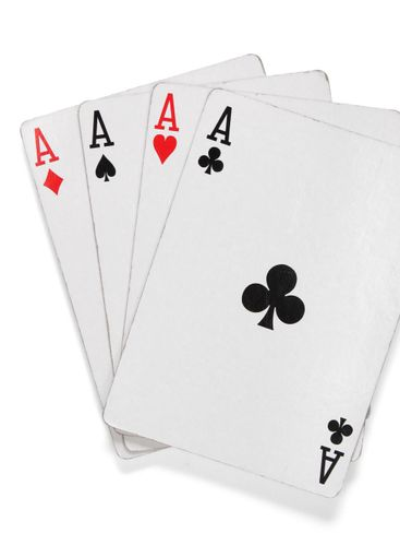 Four aces. Poker cards over white