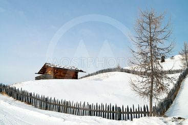 Old winter cottage with fence