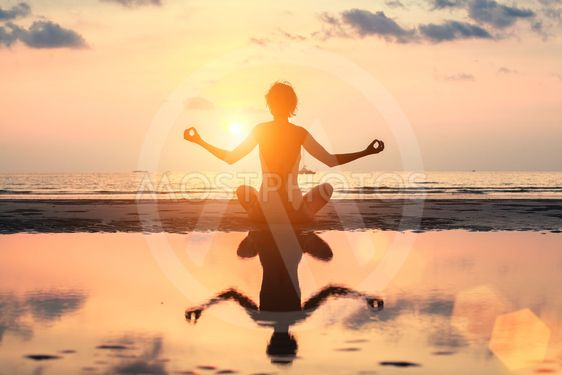 Silhouette meditation yoga woman on the background of the...
