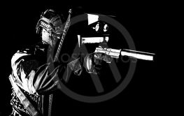 Armed SWAT fighter hiding behind ballistic shield