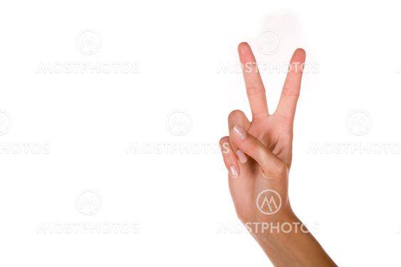 Kvinnans hand med tummen upp seger signalen