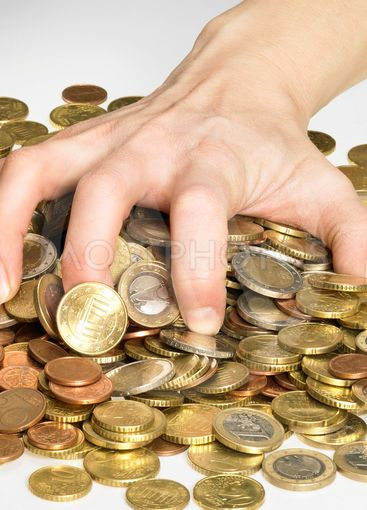 hand while gathering euro coins