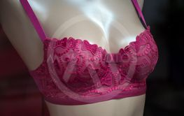 pink bra on mannequin in a fashion store for...