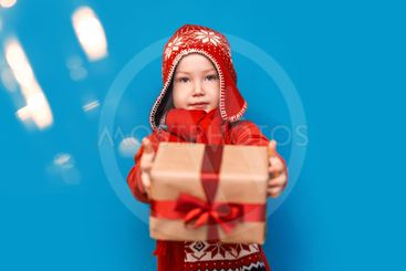 Little baby boy wear santa suit smile and show gift box...