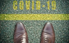 concept message on the road with feet - yellow line -...
