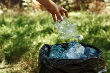 Used plastic bottles are stored in black bags for recycle.