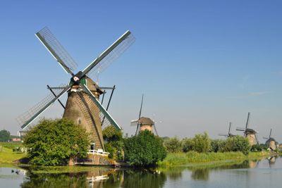 Dutch mills over a river