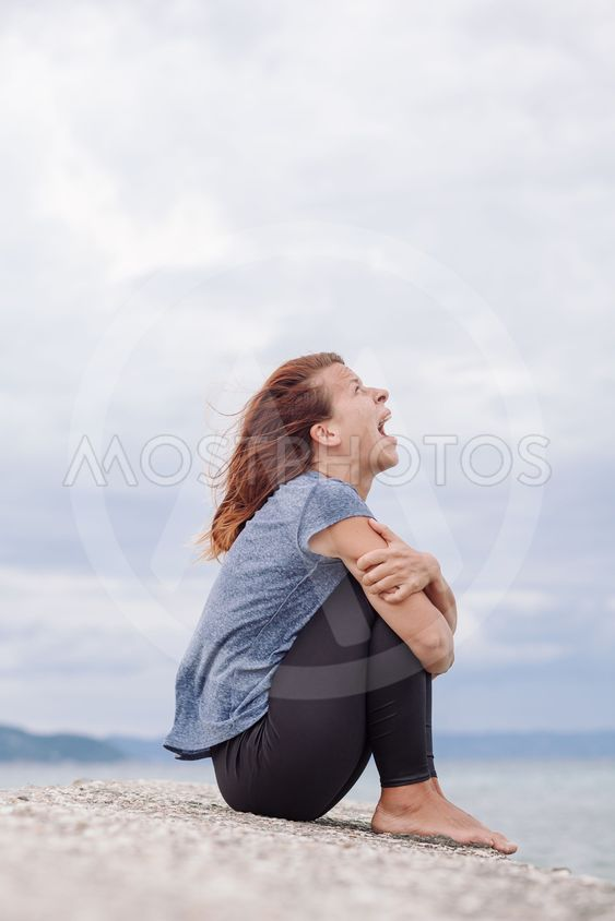 Woman alone and depressed screaming on the bridge
