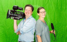 Crew of reporter and cameraman posing in the studio