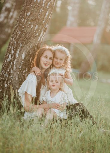 a wonderful portrait of mom with two daughters in the...