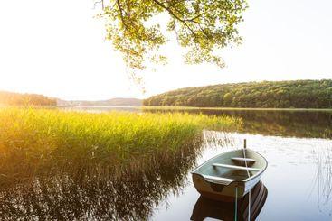 Moored boat reflection on lake