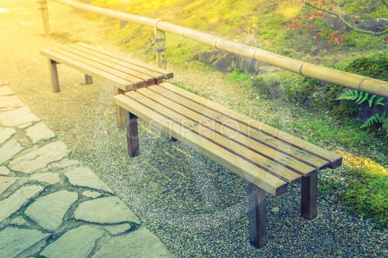 Wooden bench in the park ( Filtered image processed...