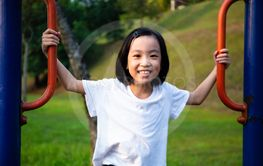 Asian Chinese little girl playing at outdoor playground
