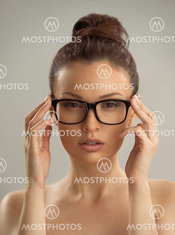 Naked girl in glasses