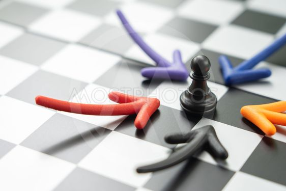 chessboard with a chess piece on the back Negotiating in...