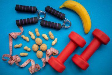 Food, measuring tape, hand grip strengthener and dumbbells