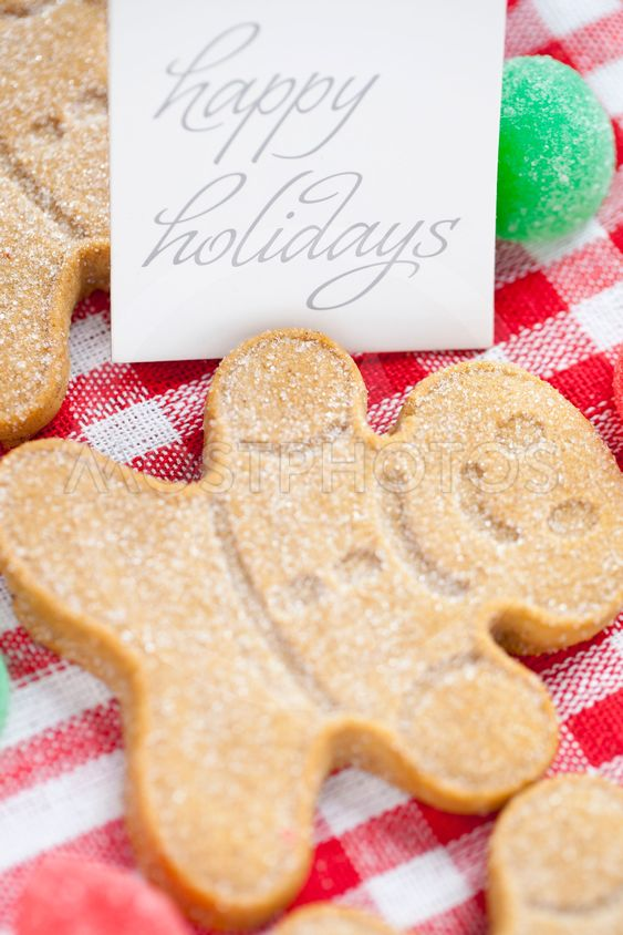 close up image of happy holidays tag with gingerbread...