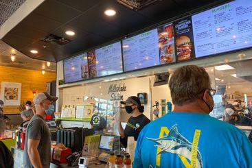 People ordering food at a Burger Fi fast food restaurant...