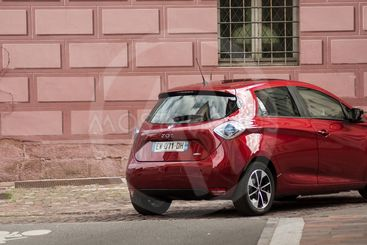 Closeup of red renault Zoe in the street  - electric car...