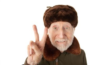 Russian Man in Fur Cap Making Peace Sign