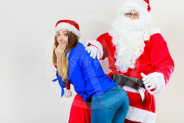 Santa Claus spanking woman with christmassy hat