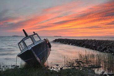 Moored fishing boat on shore, Vänern, Sweden, Europe