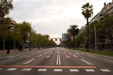 Empty road on the crowded city